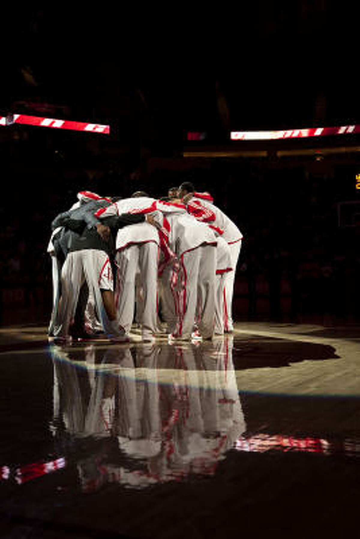 Rockets players huddle before playing the Minnesota Timberwolves at the Toyota Center.
