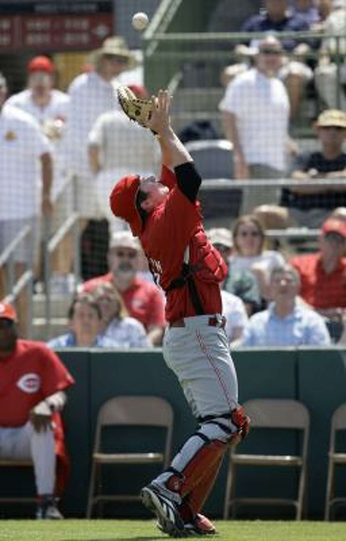 Cincinnati Reds catcher Ryan Hanigan catches a ball in foul territory hit by Astros shortstop Miguel Tejada during the second inning.