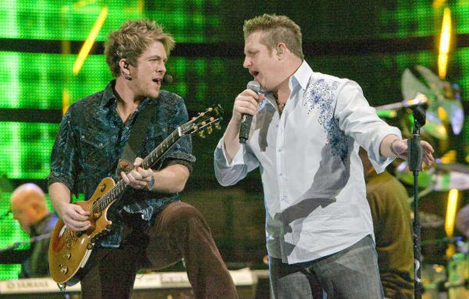 Guitarist Joe Don Rooney and lead singer Gary LeVox of the trio Rascal Flatts opened RodeoHouston on Tuesday night. Photo: Steve Campbell, Houston Chronicle