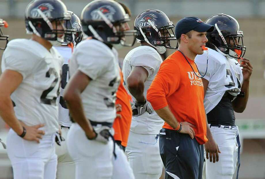 When UTSA begins fall practice today, offensive coordinator Travis Bush says there will be open competition at every position. Photo: Kin Man Hui/kmhui@express-news.net / San Antonio Express-News