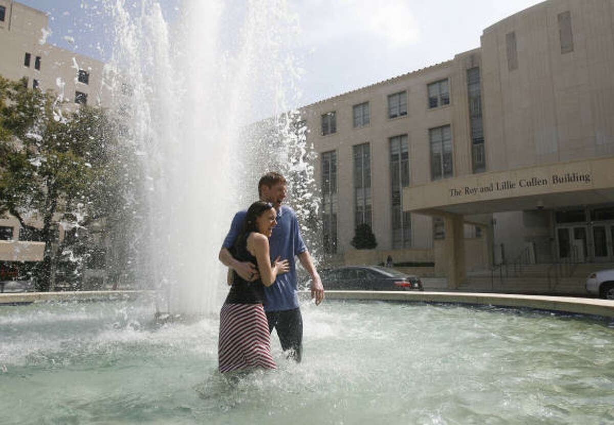 """""""We have a habit of jumping into fountains, so we saved this fountain for match day"""" says Molly Christensen, specialty in Pediatrics, and fiancee Jeff Reitsema, specialty in Emergency Medicine. They both 'matched' to do residency in Albequerque."""