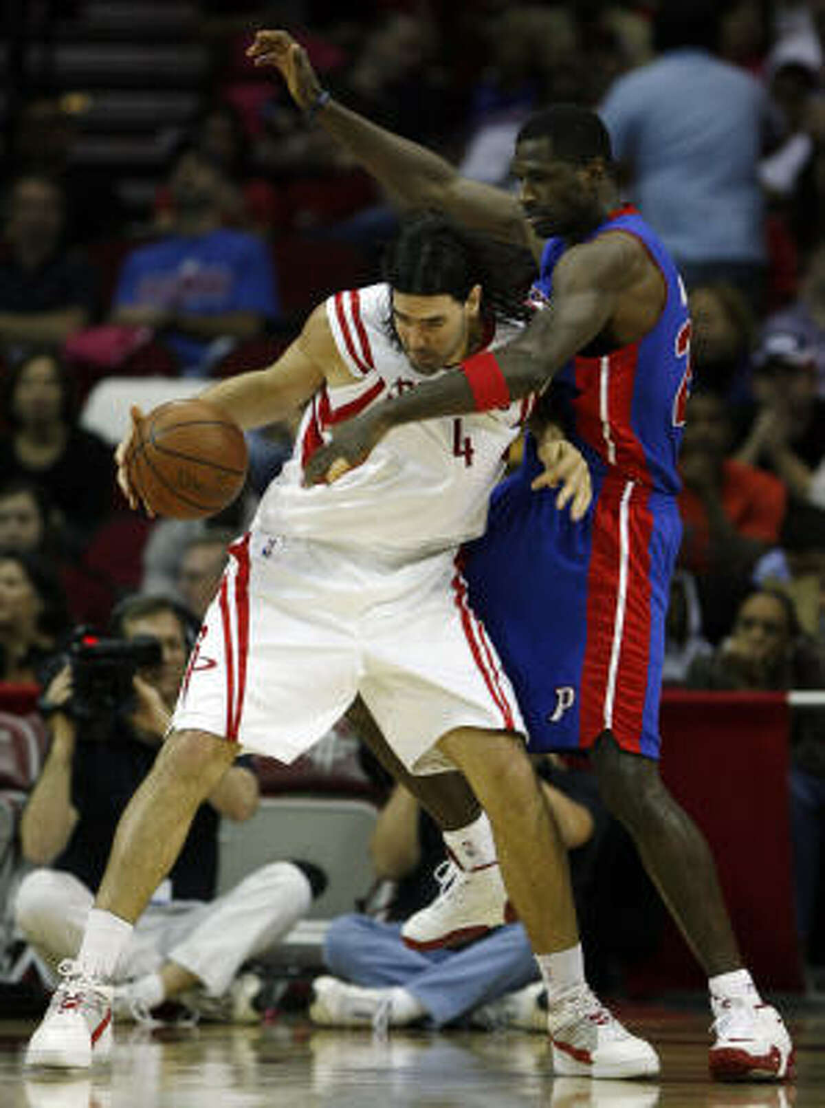 Luis Scola commits an offensive foul against Pistons forward Antonio McDyess in the second half. Scola scored 14 points to go along with six rebounds.