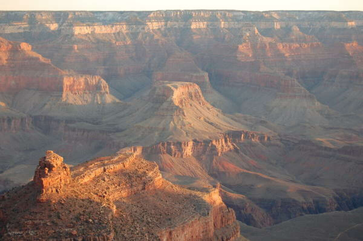 The patio behind Bright Angel Lodge is a popular spot to photograph the sunrise at the Grand Canyon.