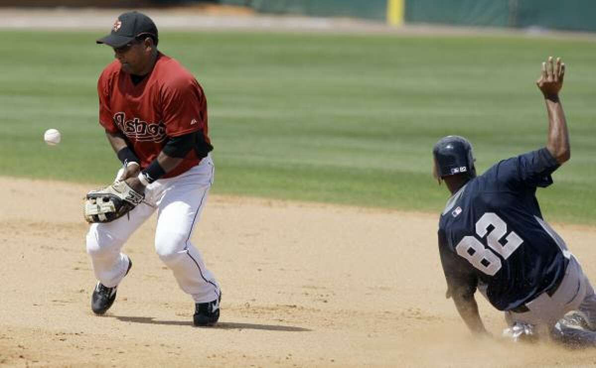 Astros shortstop Miguel Tejada, left, bobbles the throw as New York's Austin Jackson steals second base in the Yankees' 4-1 victory.