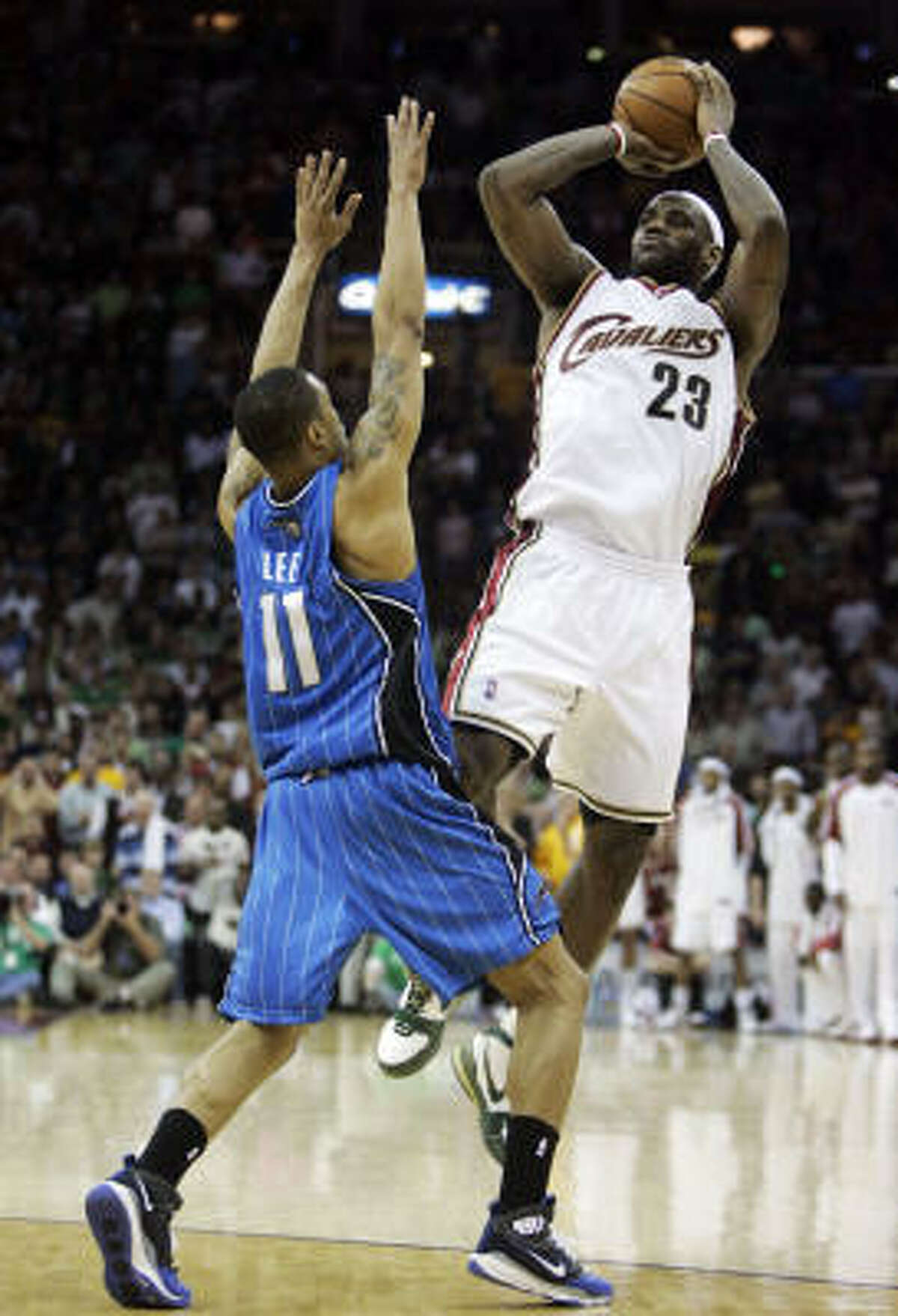 Cavaliers beat Magic 97-93 : Cleveland forward LeBron James, right, is fouled by Orlando Magic guard Courtney Lee late in the fourth quarter on Tuesday in Cleveland. James scored 43 points in the win.
