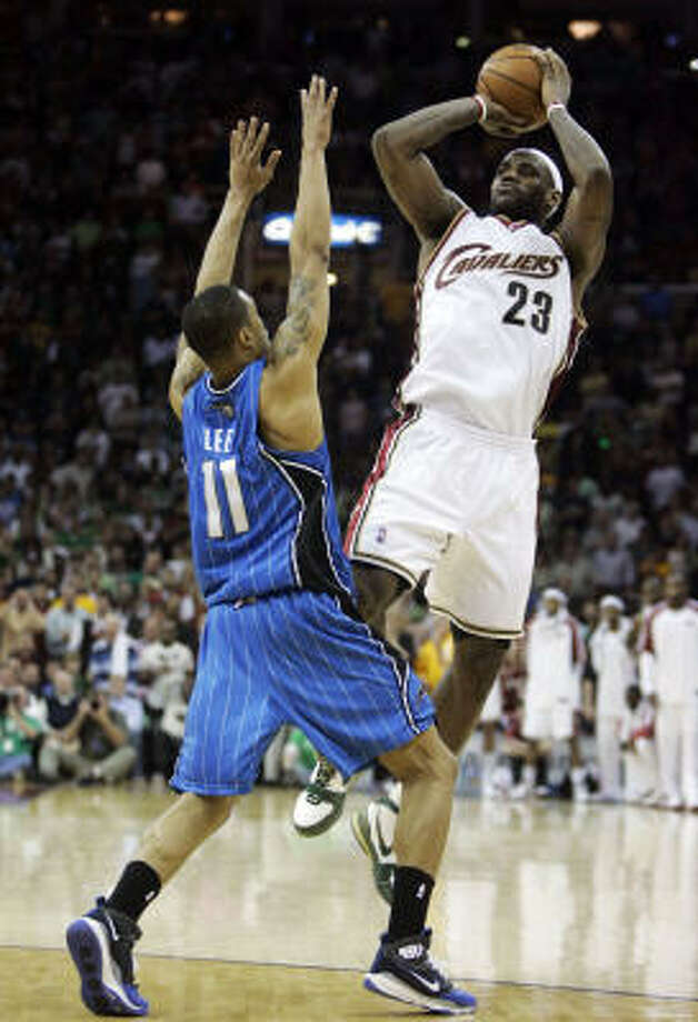 Cavaliers beat Magic 97-93:  Cleveland forward LeBron James, right, is fouled by Orlando Magic guard Courtney Lee late in the fourth quarter on Tuesday in Cleveland. James scored 43 points in the win. Photo: Tony Dejak, AP