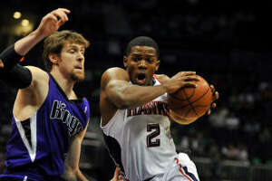 Atlanta Hawks guard Joe Johnson (2) drives against Sacramento Kings forward Andres Nocioni, left.