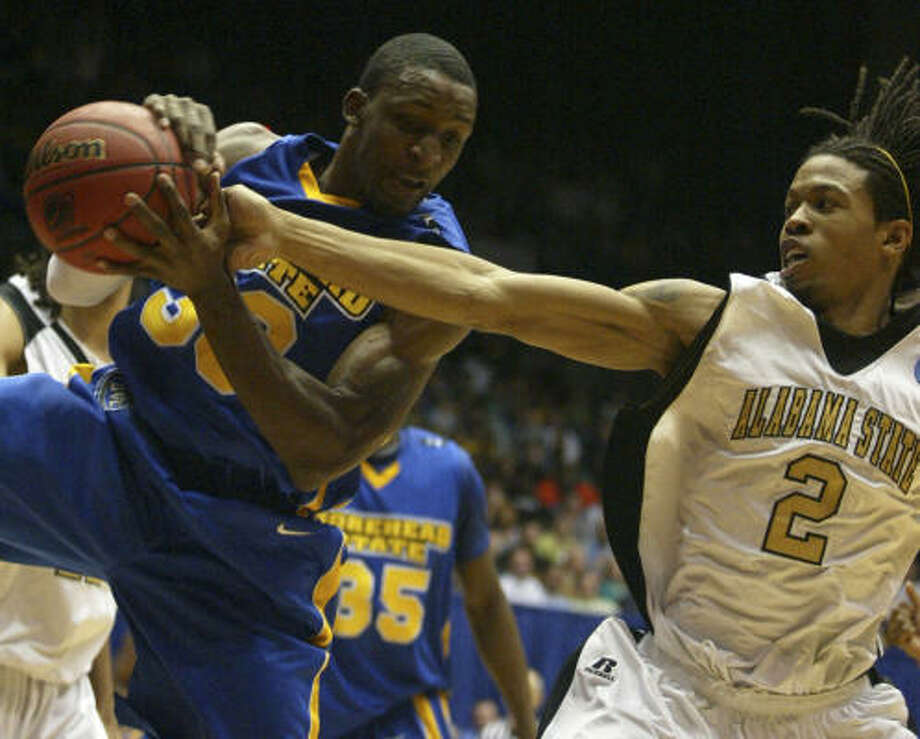 Opening Round Game: Morehead State 58, Alabama State 43. Morehead State forward Leon Buchanan, left, and Alabama State guard Andrew Hayles fight for a rebound in the first half on Tuesday in Dayton, Ohio. Photo: Skip Peterson, AP