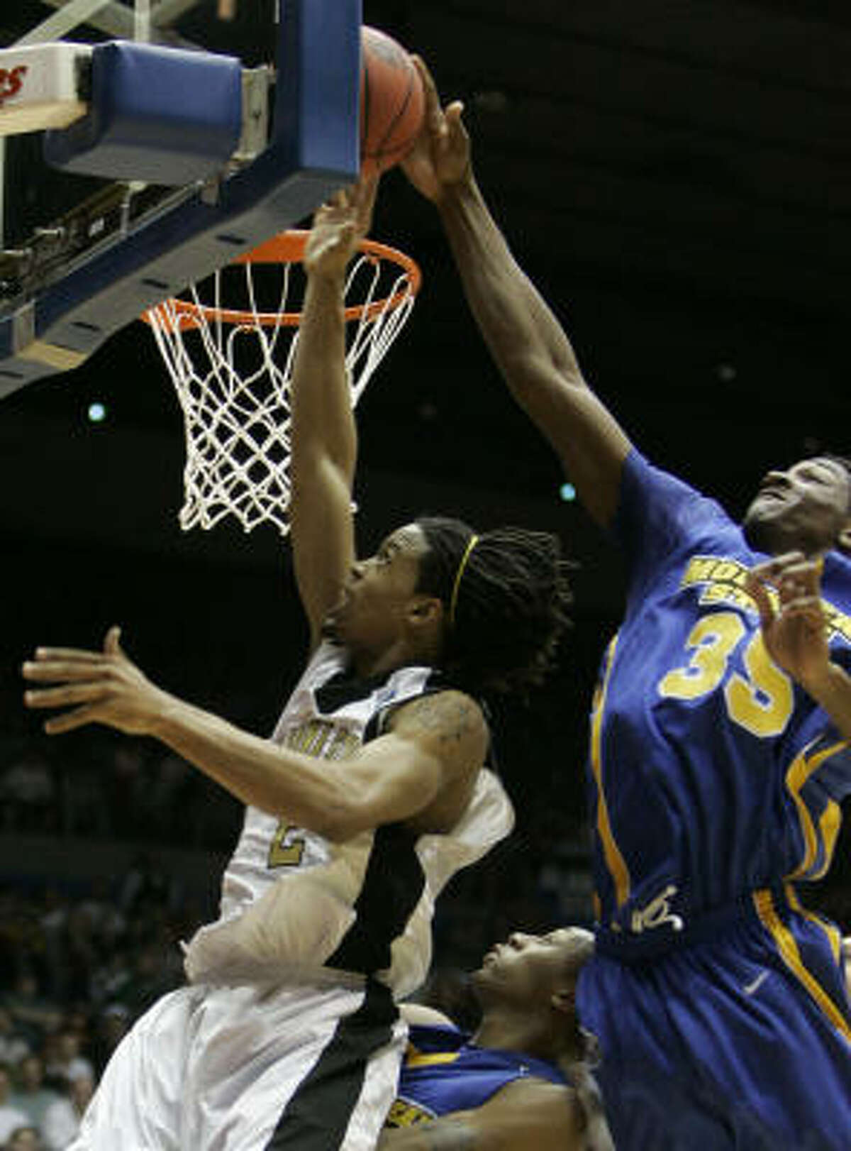 Opening Round Game: Morehead State 58, Alabama State 43. Morehead State forward Kenneth Faried (35) blocks a shot by Alabama State guard Andrew Hayles (2) in the first half.