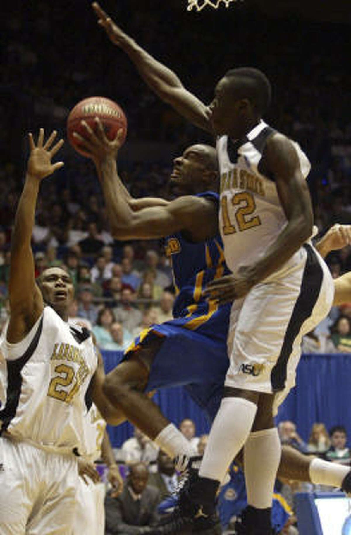 Opening Round Game: Morehead State 58, Alabama State 43. Morehead State guard Brandon Shingles, center, drives between Alabama State defenders Tramaine Butler (21) and Ivory White (12) in the first half.