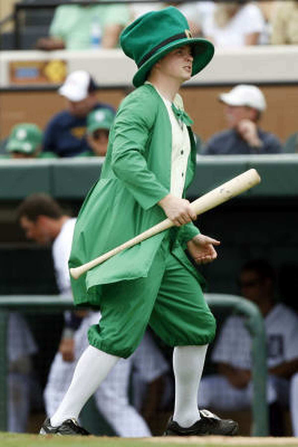 The bat boy, 18-year-old Kyle Dauer of Toledo, Ohio, is dressed as a leprechaun in honor of St. Patrick's Day.