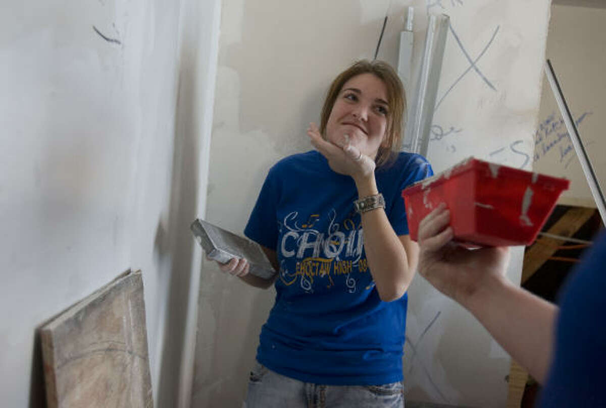 Some travelers are pitching in this year for Hurricane Ike relief during their spring breaks. Skye Snowden, 17, of Naicoma Park, Okla., was working Monday at a house in Seabrook. About 800 volunteers have come to Galveston County
