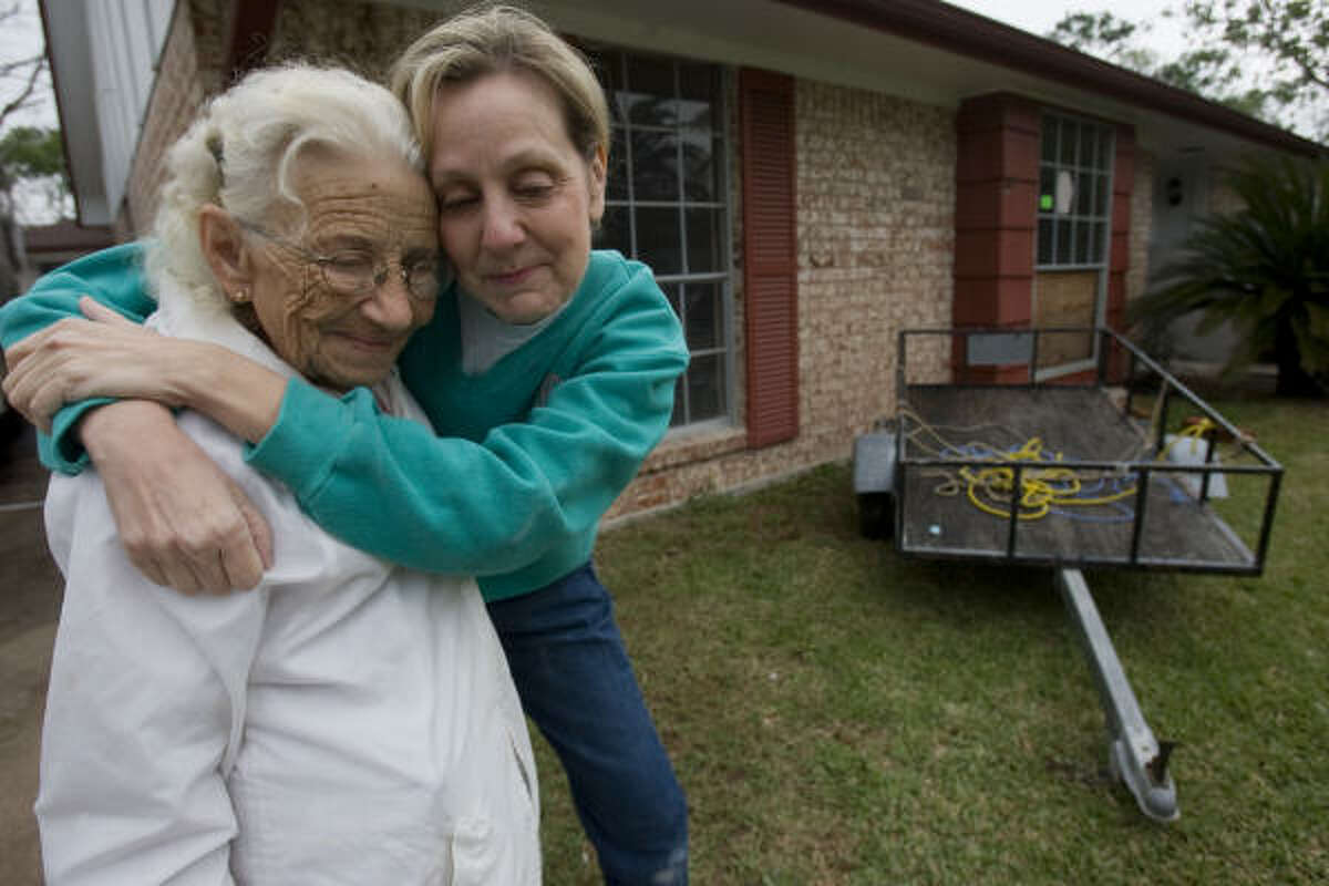 Mary Anne Klingen, right, hugs home owner Norma Ackermann, 79, for work in Seabrook. Klingen and several others from Tallowwood Baptist Church in Houston worked to repair damage.