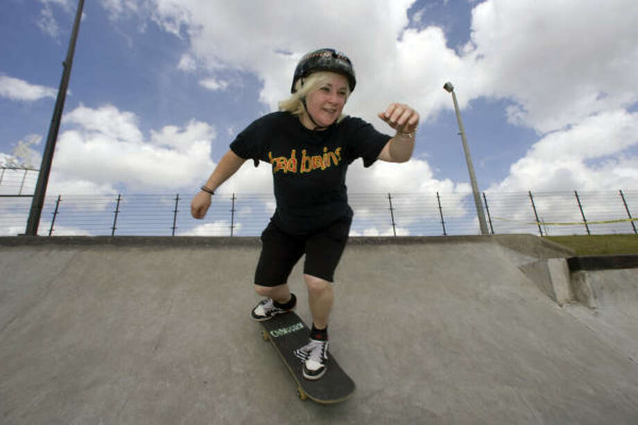 """Lori Peltier, organizer of the """"Babes on Boards"""" jam at Jamail Skate Park, learned """"vert skating"""" the old-school way: In a drained swimming pool, with a friend watching for the cops. Photo: Johnny Hanson, Chronicle"""