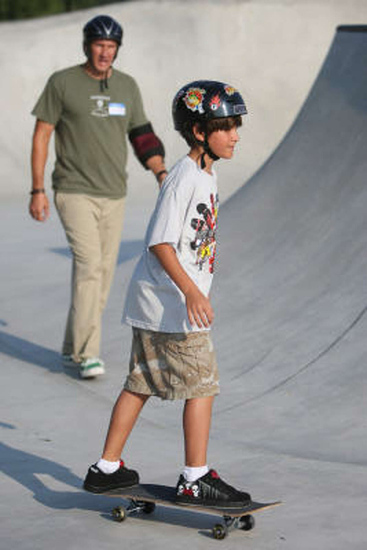 Skating, once a wild thing, is becoming a wholesome family activity, encouraged by the City of Houston Parks Department. (Shown here: Mike Niemann and Billy Moran at a Jamail skate clinic.)