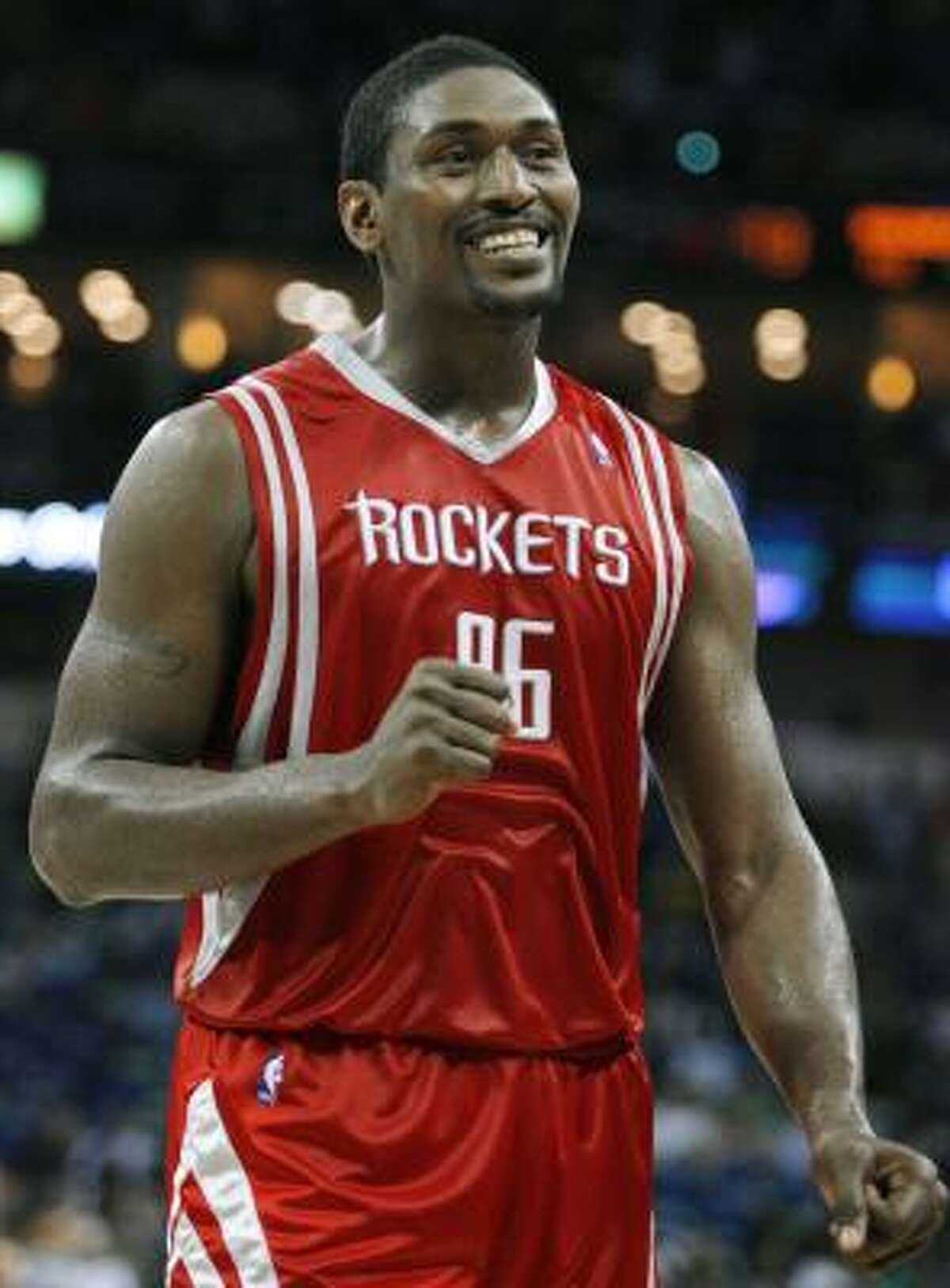 Rockets forward Ron Artest smiles after a play during the second half . Artest shook off a poor-shooting start to score 18 points in Monday's win against the Hornets.