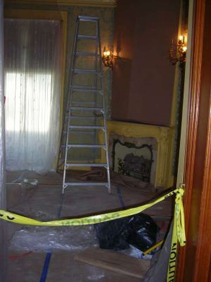 As you enter the Moody Mansion, the sitting room in the front left portion of the house is still undergoing repairs. Photo: Mike Madere, Houston Chronicle