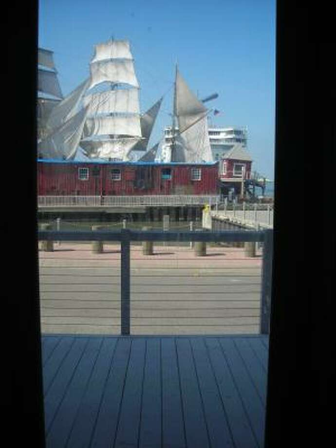 The tall ship Elissa is framed in one of the widows of the Olympia at Pier 21 restaurant, which is under construction. Photo: Mike Madere, Houston Chronicle