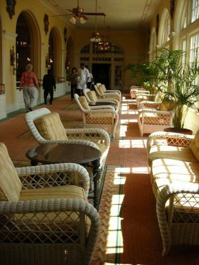 The Hotel Galvez has been open for months. Its restaurants and ballrooms are open, and the hotel is expecting to host about 120 weddings this year. Part of the hotel's lobby is featured in this photograph. Photo: Mike Madere, Houston Chronicle