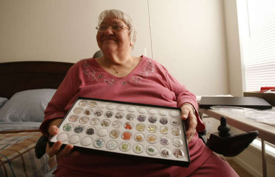 Margaret Winters, 79, is seen in her new bedroom as she displays the beads she purchased to build jewelry and restart her collection. Winters lost most of her collectibles during Hurricane Ike and recently moved into her new apartment in Galveston. Photo: Julio Cortez, Chronicle