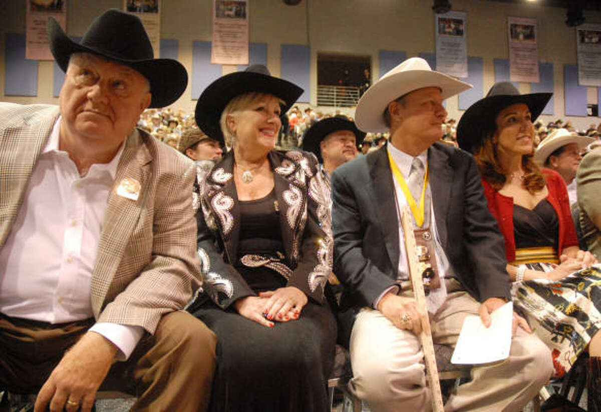 Reserve Champion bidders, from left, Jerrol and Pam Springer and Jim and Lynda Winne wait to raise the bid.