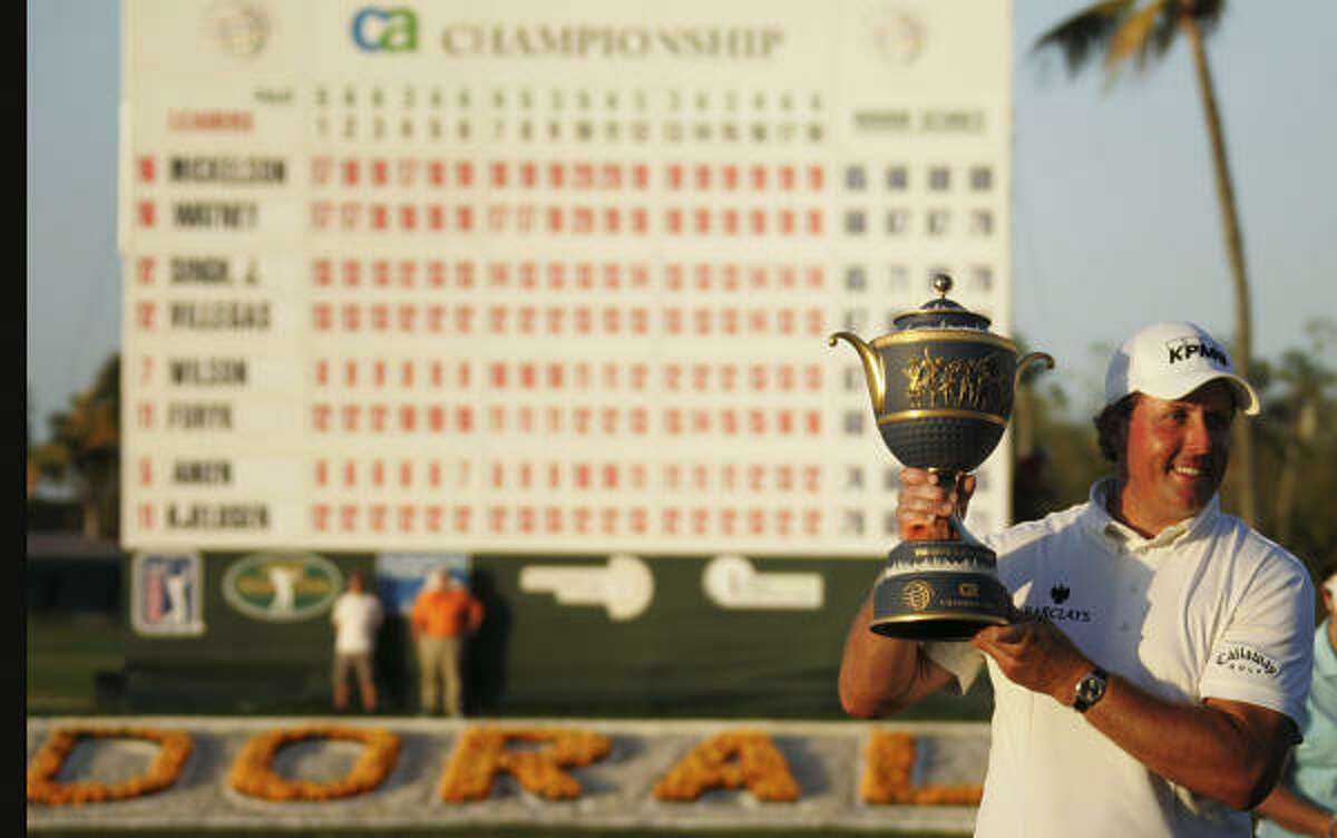 Phil Mickelson poses for photos after winning the CA Championship. Mickelson finished at 19-under 269 and earned $1.4 million, the biggest check of his career.