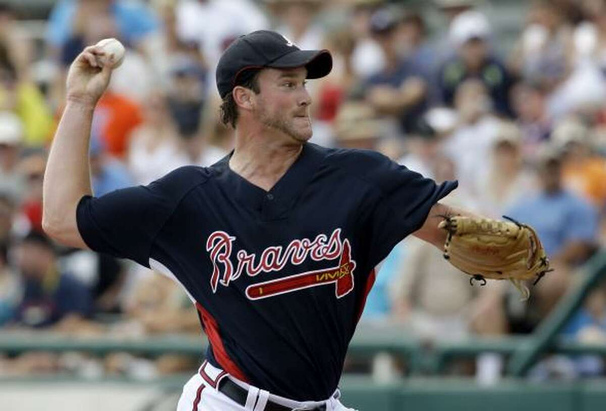 Atlanta Braves pitcher Derek Lowe throws to a Astros batter during the first inning.