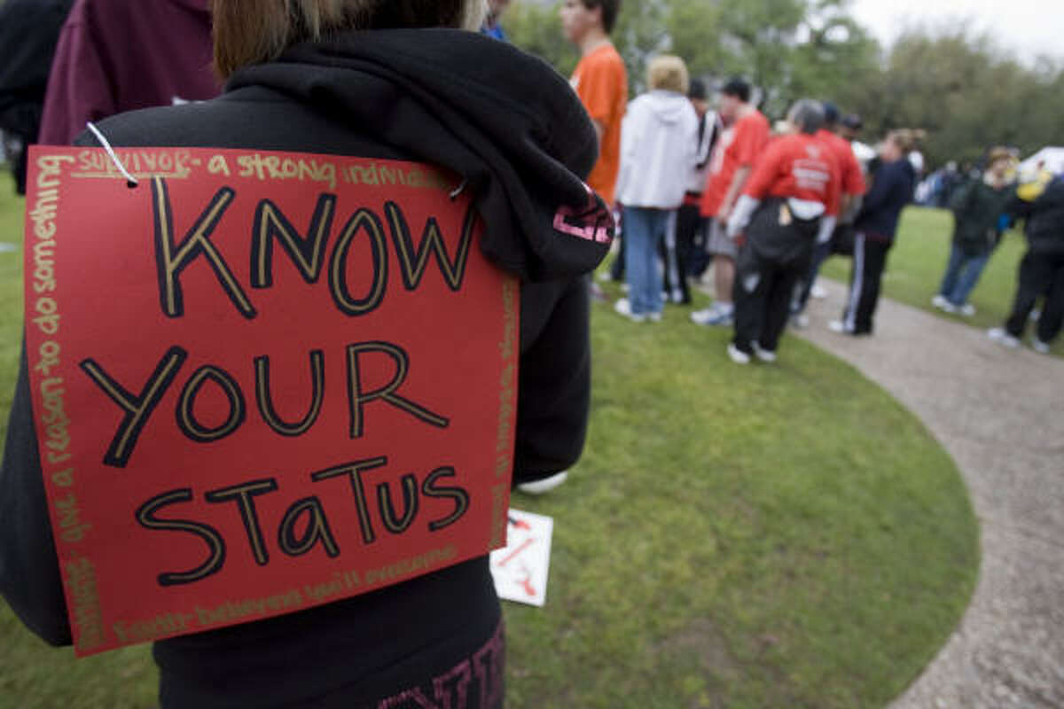 Walkers assemble in Sam Houston Park before the start of the 20th Annual AIDS Walk Houston on Sunday.