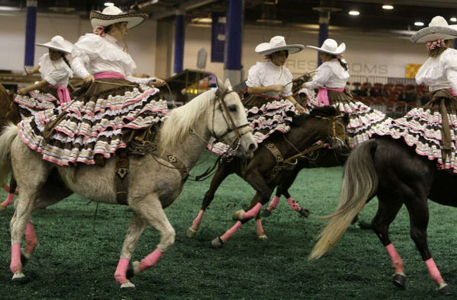 Las Christares, a female sidesaddle horse drill team from Houston, practice for their next performance at the Fiesta Charra in Reliant Center on Go Tejano Day at the Houston Livestock Show and Rodeo on Sunday, March 15, 2009, in Houston. Photo: Melissa Phillip, Chronicle