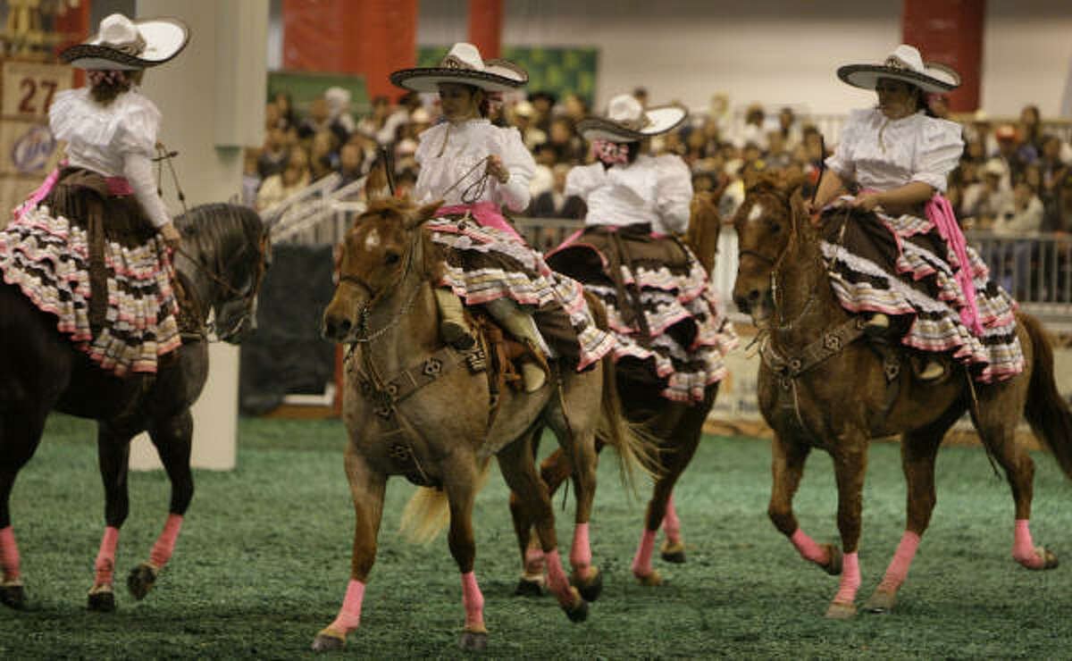 Las Christares, a female sidesaddle horse drill team from Houston, perform at the Fiesta Charra in Reliant Center on Go Tejano Day at the Houston Livestock Show and Rodeo on Sunday, March 15, 2009, in Houston.