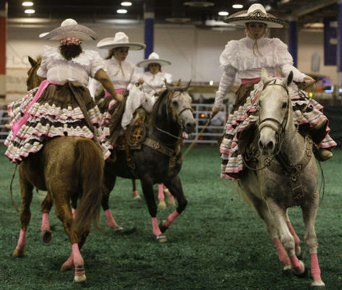 Las Christares, a female sidesaddle horse drill team from Houston, practice for their next performance at the Fiesta Charra in Reliant Center on Go Tejano Day at the Houston Livestock Show and Rodeo on Sunday, March 15, 2009, in Houston.