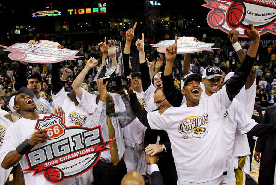 Championship game:Missouri coach Mike Anderson hoists the championship trophy after the Tigers defeated Baylor 73-60 in the Big 12 tournament championship game Saturday in Oklahoma City. Photo: Rich Sugg, MCT
