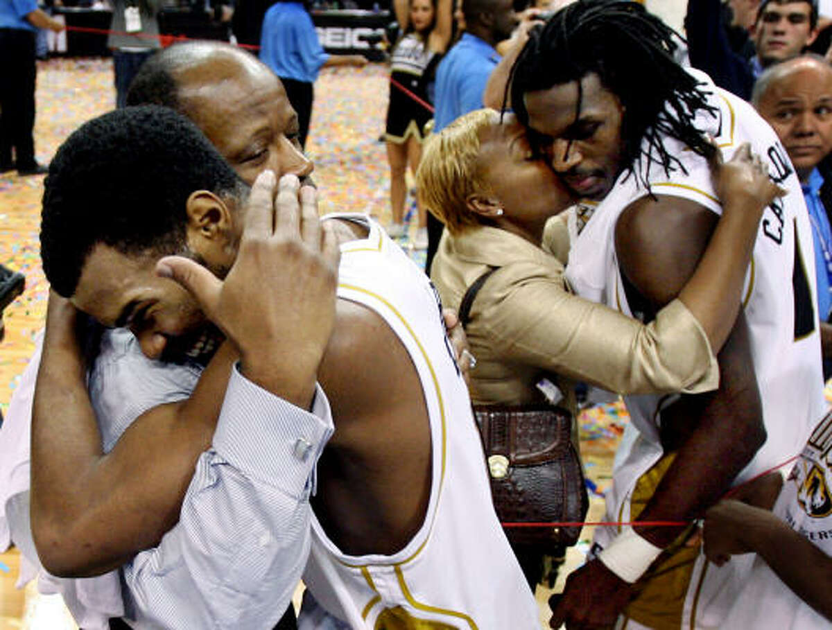 Championship game: Missouri's Zaire Taylor hugs coach Mike Anderson while tournament MVP DeMarre Carroll gets a hug from Anderson's wife, Marcheita, after Saturday's win.