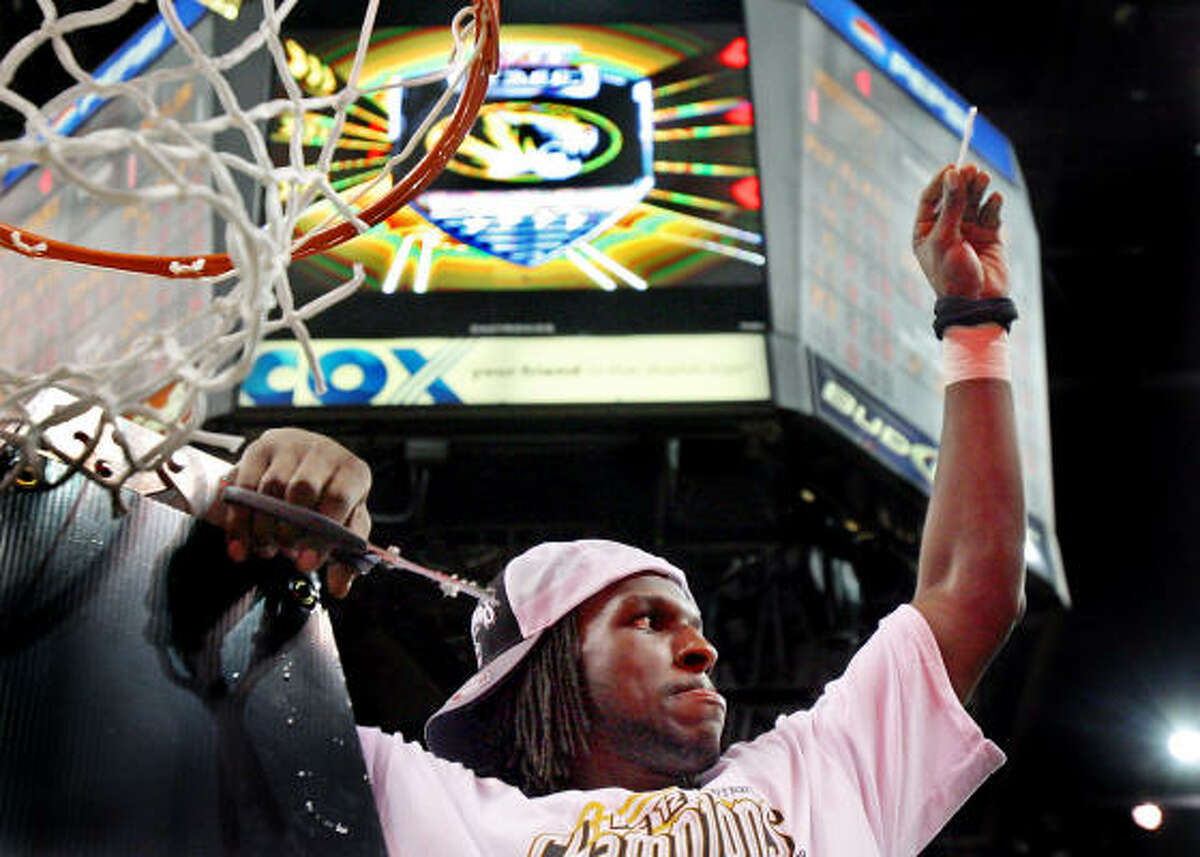 Championship game: Tournament MVP DeMarre Carroll showed the Tiger faithful his piece of the net after the Saturday's 73-60 victory over Baylor.