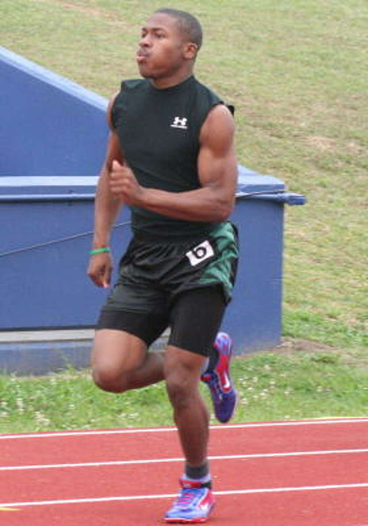 Austin's Bryan Smith distances himself from the field in the 100 meters.