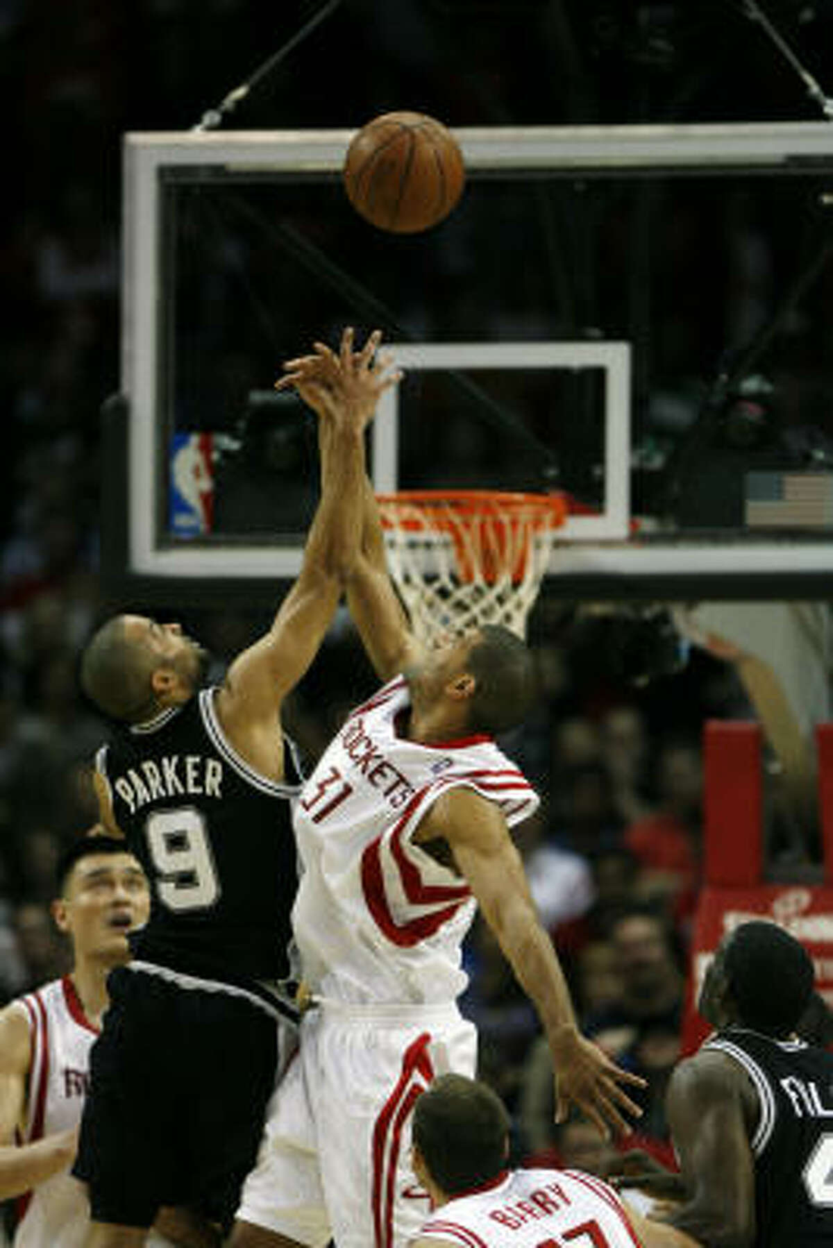 Another shot of Spurs guard Tony Parker (9) Shane Battier on a jumpball late in the fourth quarter.