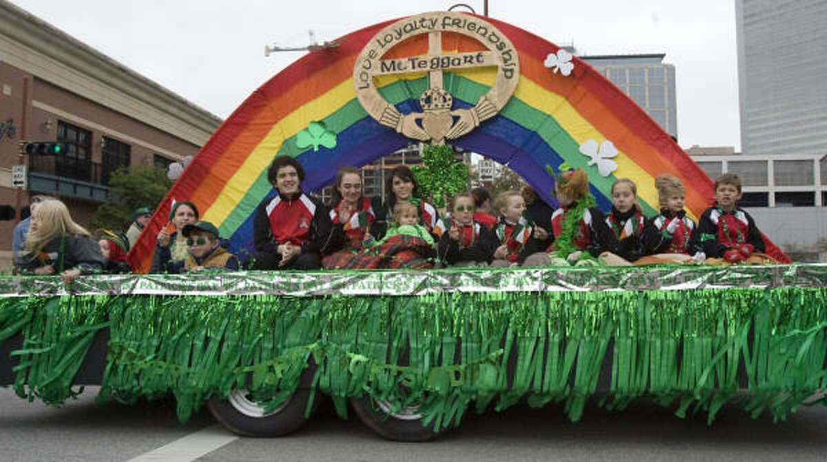 A float in the 50th annual Houston St. Patrick's Day Parade rolls through downtown on Saturday.