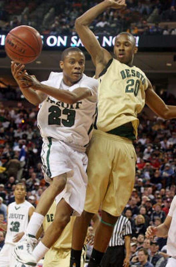 Strake Jesuit's Tim Frazier (23) loses the ball against DeSoto's Keith Davis during the 5A boys basketball semifinal game in Austin on Friday, March 13. DeSoto won 48-44. Photo: Jack Plunkett, Associated Press