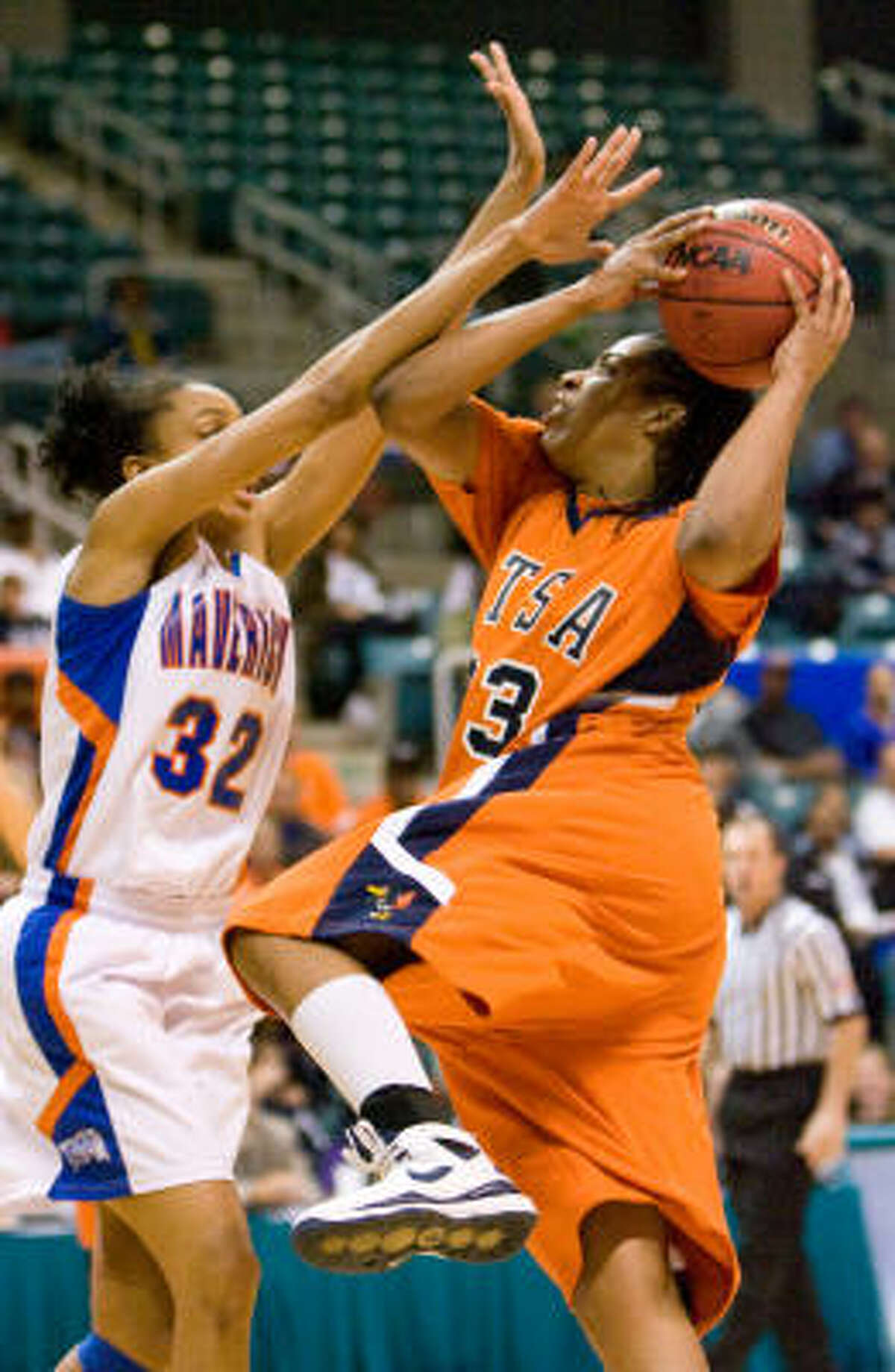 UTSA's Monica Gibbs (right) goes up for a shot against UT Arlington's Shalyn Martin in the second half. UTSA defeated UT Arlington 74-63 in the finals of the Southland Conference Tournament.