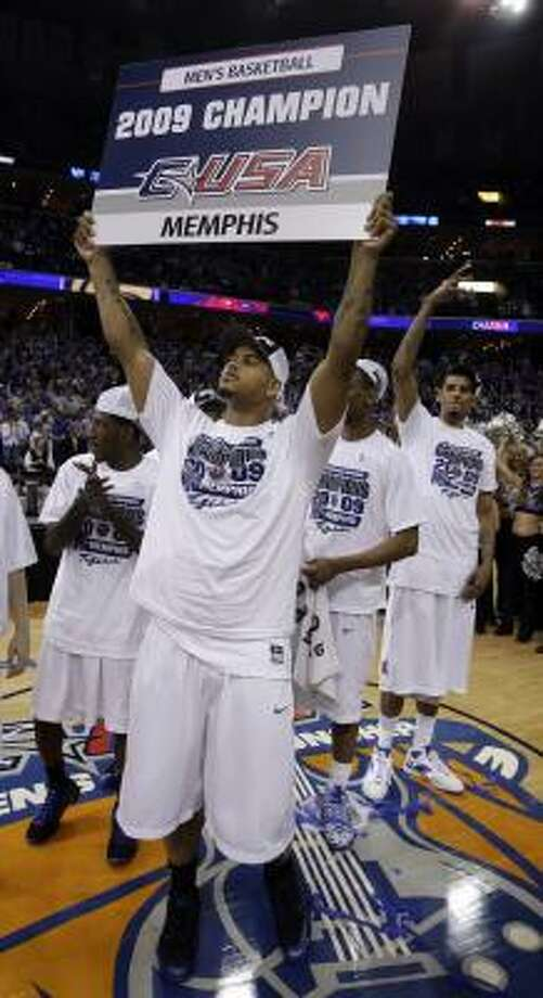 Championship game:Memphis forward Pierre Henderson-Niles holds up a sign for fans after the Tigers clinched their fourth straight C-USA tournament title with a 64-39 win over Tulsa. Photo: Mark Humphrey, AP