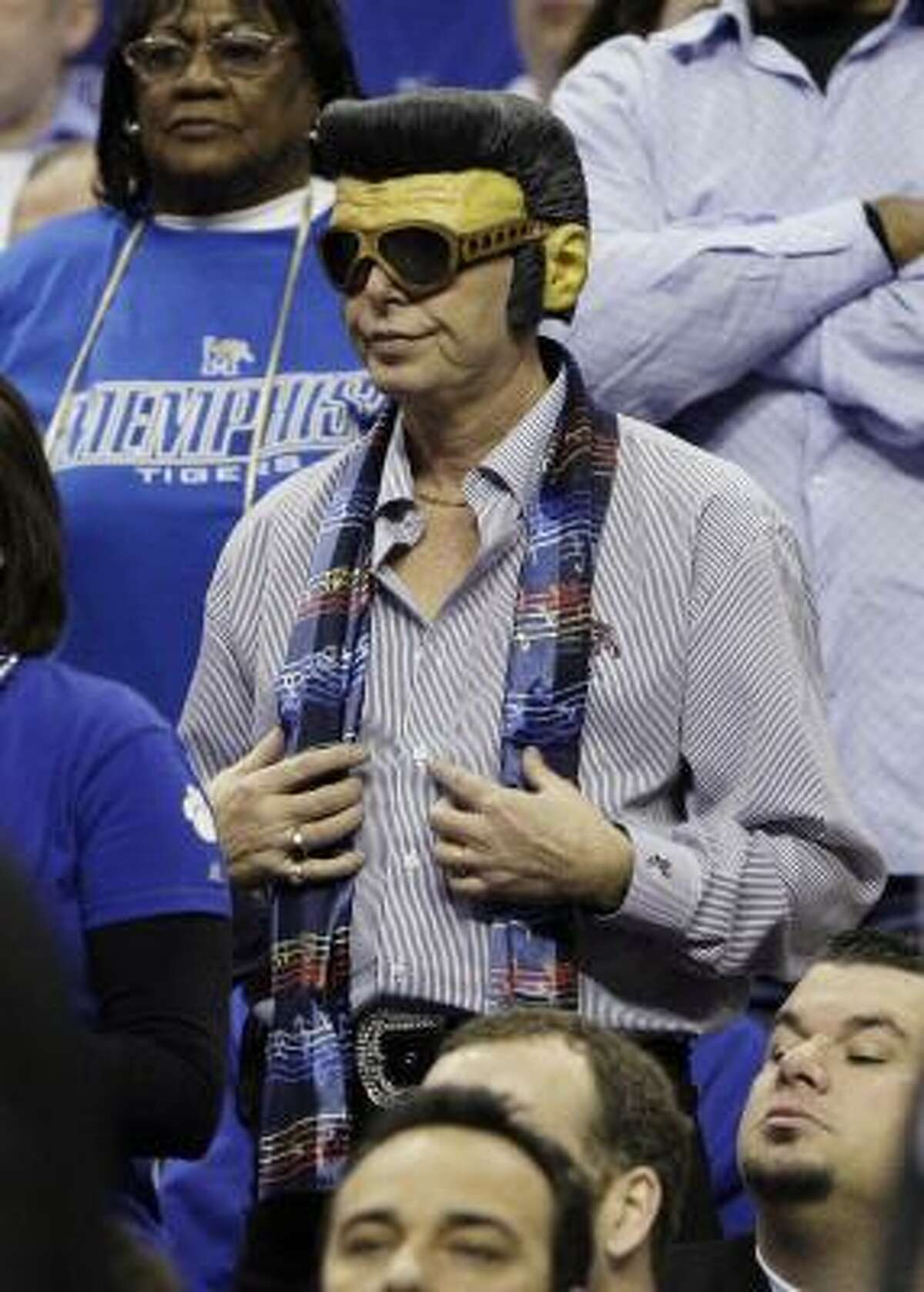Championship game: A fan in an Elvis mask and scarf watches Memphis play Tulsa in the Conference USA tournament championship game.