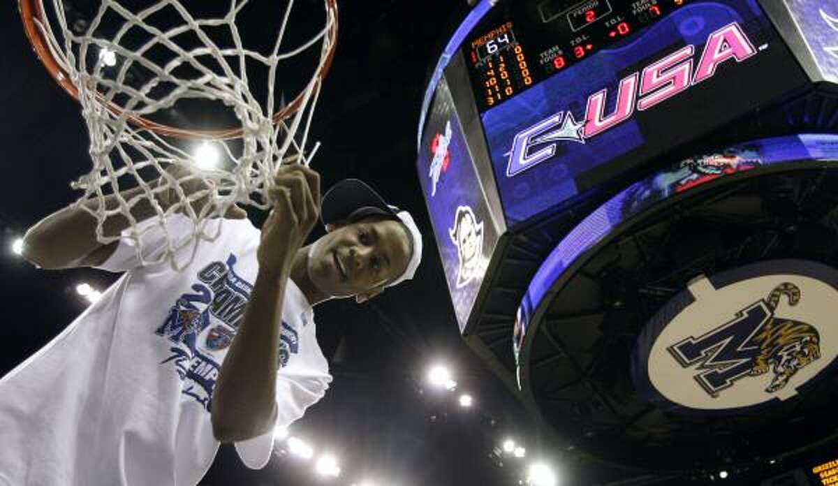 Championship game: Memphis' Wesley Witherspoon cuts down the net after beating Tulsa 64-39 in the C-USA championship game.