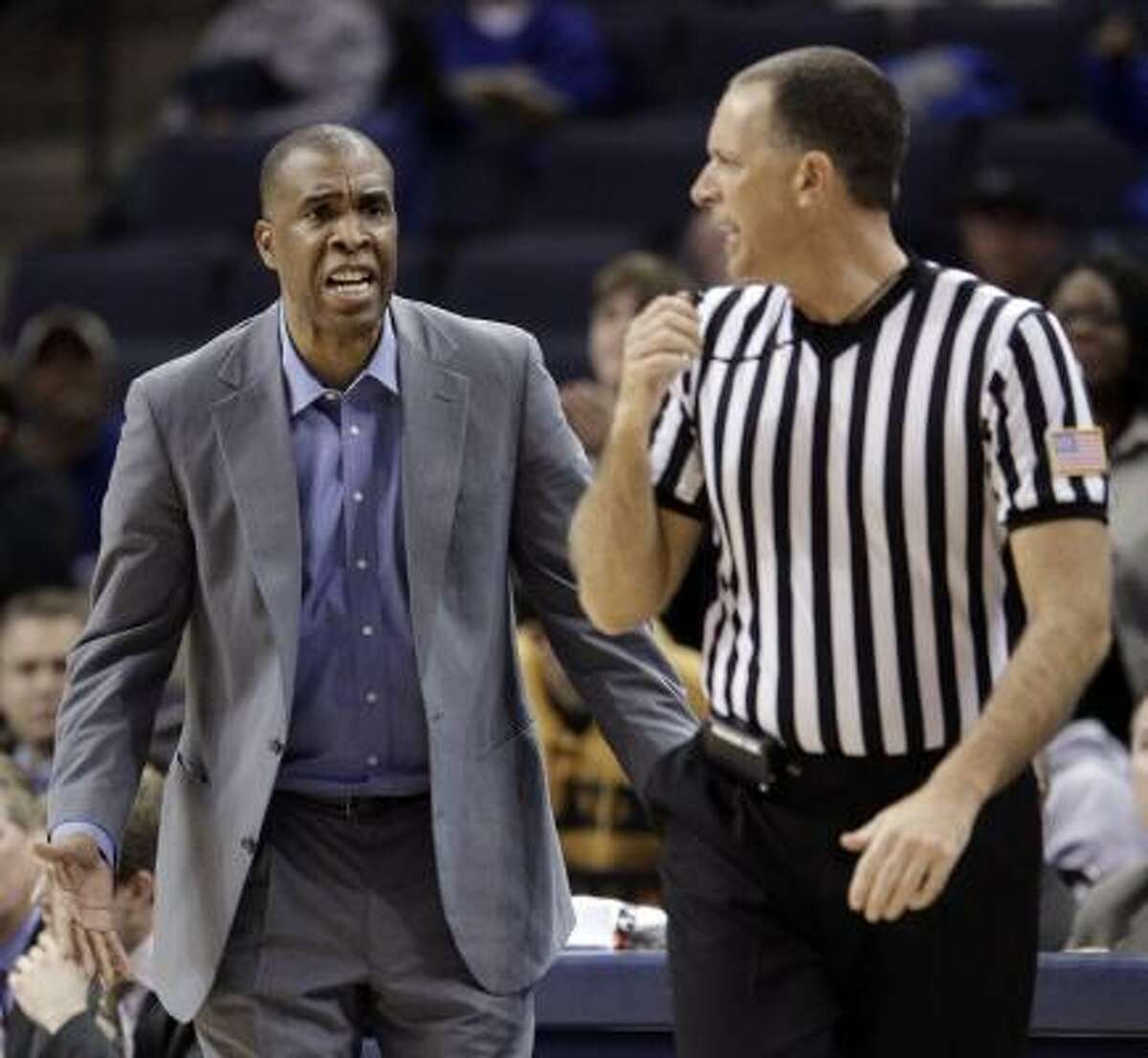 UAB coach Mike Davis pleads his case with an official during Thursday's game against Southern Miss.