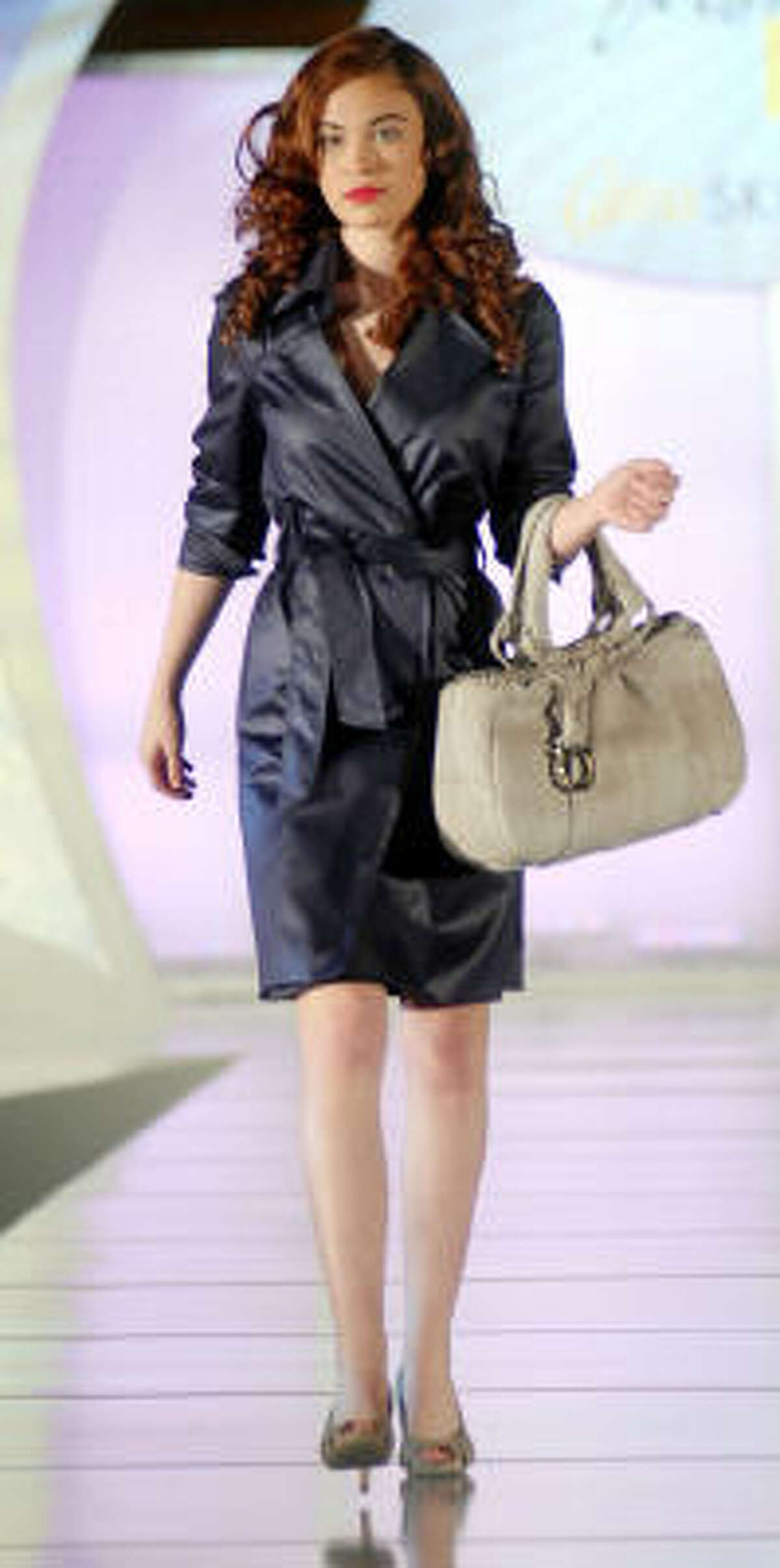 A Salvatore Ferragamo black trench is a classic for spring.