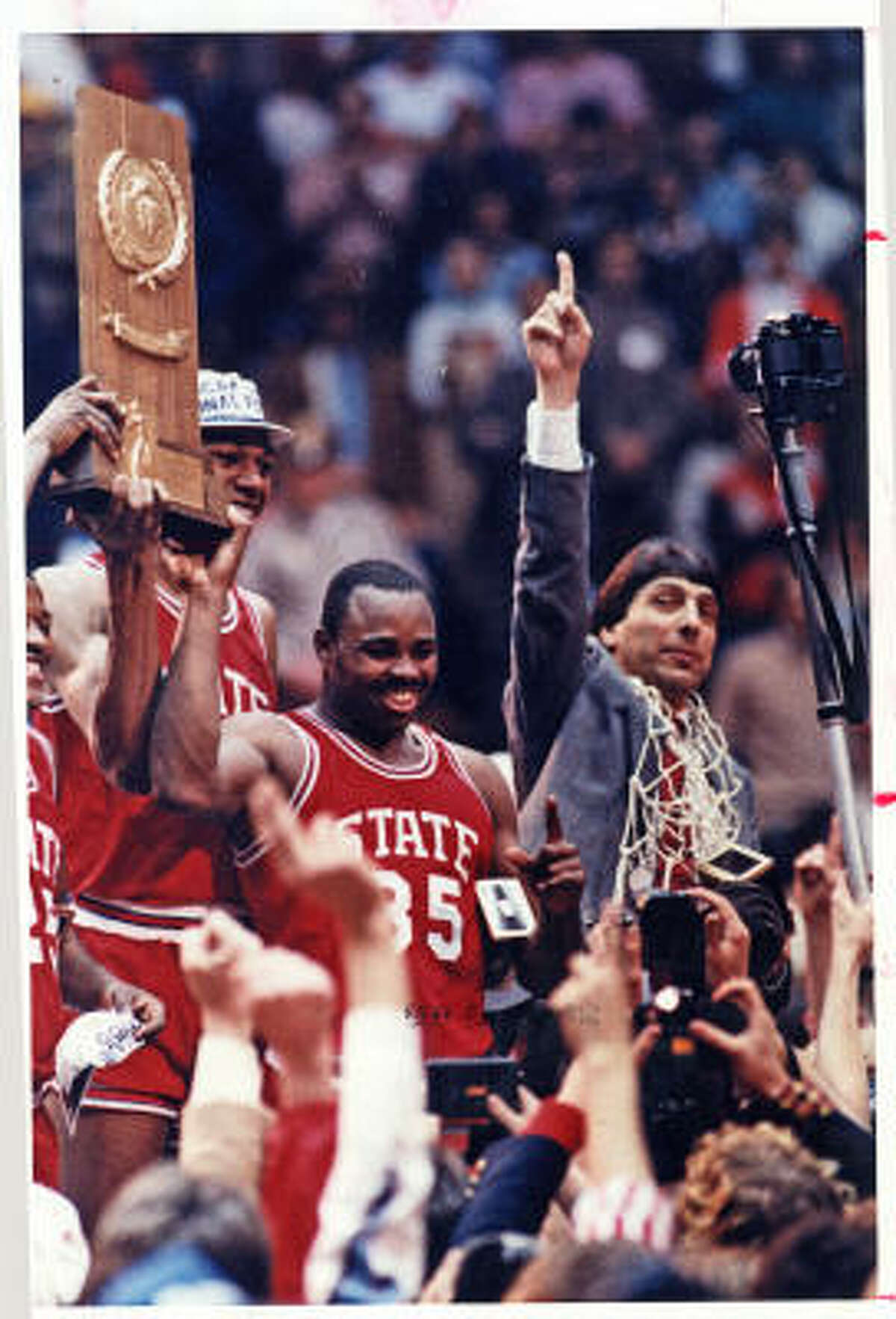 Jim Valvano coach of North Carolina State University celebrates a win over the university of Houston for the 1983 NCAA championship. His story is the focus of a TV movie airing tonight