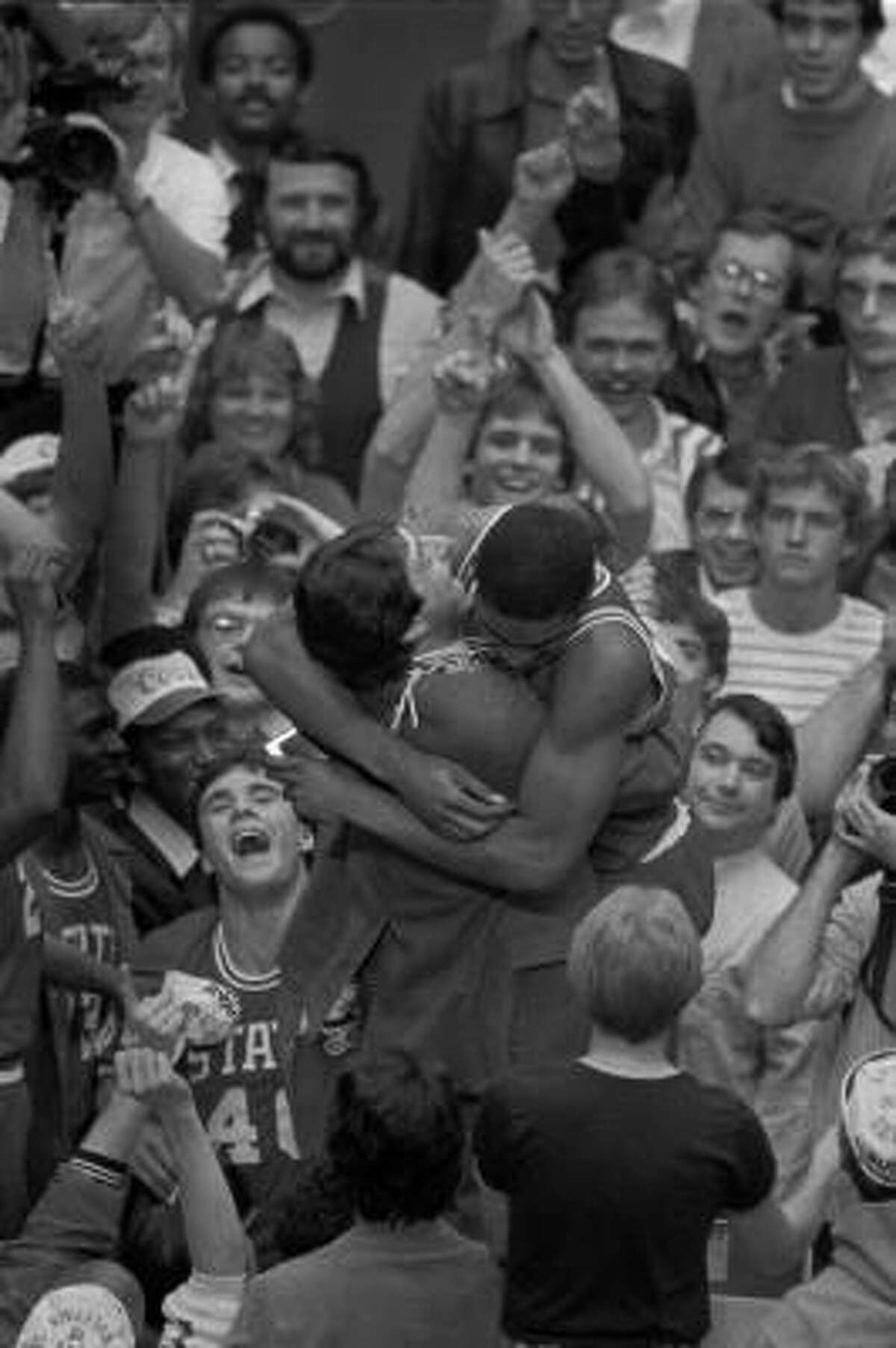 North Carolina State coach Jim Valvano embraces sophomore forward Lorenzo Charles moments after Charles had dunked a shot to give North Carolina State the win over the University of Houston April 5, 1983 in the NCAA final at Albuquerque. (AP Photo/Stf/Leonard Ignelzi)