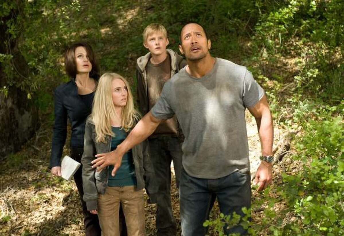 Fans of the original Escape to Witch Mountain will find many new characters in the updated version. From left are Dr. Alex Friedman (Carla Gugino), Sara (AnnaSophia Robb), Seth (Alexander Ludwig) and Jack Bruno (Dwayne Johnson).