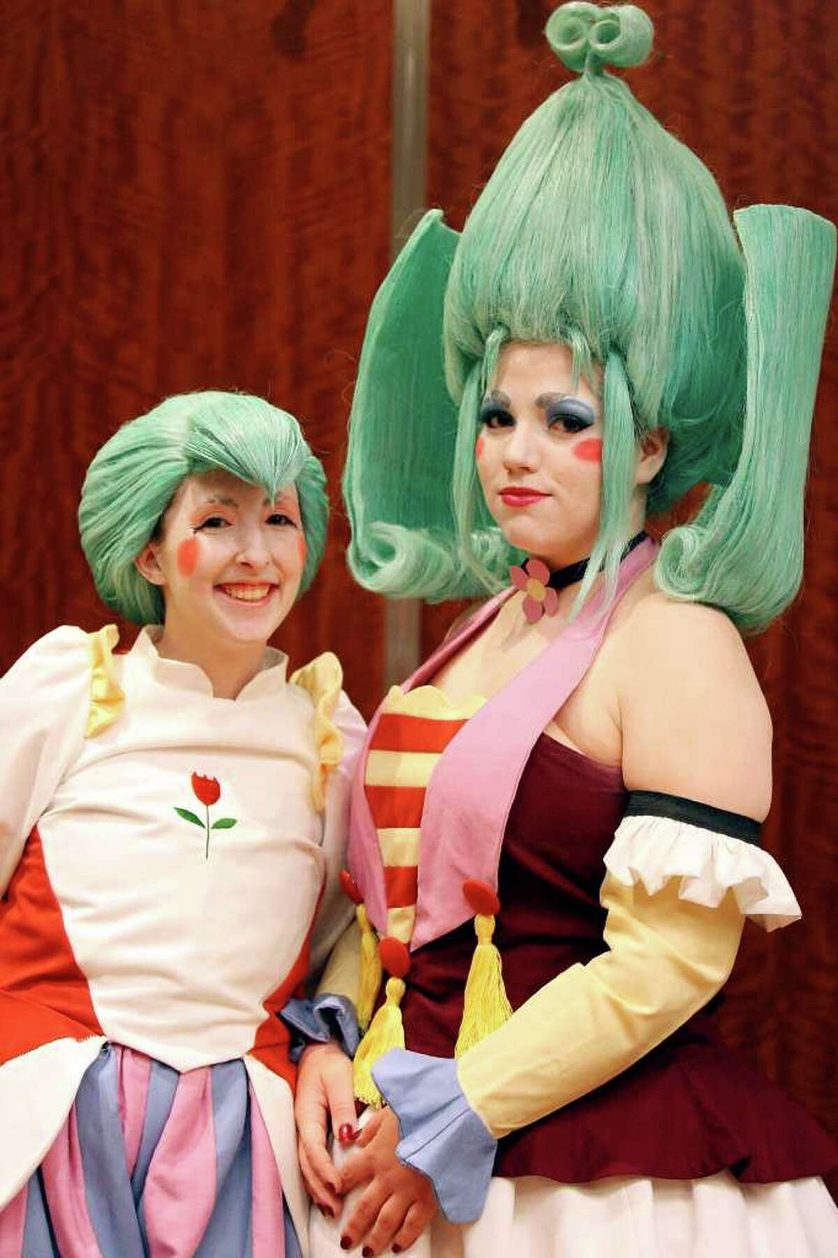 """Jenny Pennington, 28, as """"Uzura"""" (left) and Beauty Thibodeau, 23, as """"Edel """"pose for a photo while attending the San Japan 4TW convention Saturday Aug. 6, 2011 at the Marriott Rivercenter. San Japan 4TW runs Aug. 5-Aug. 7th."""