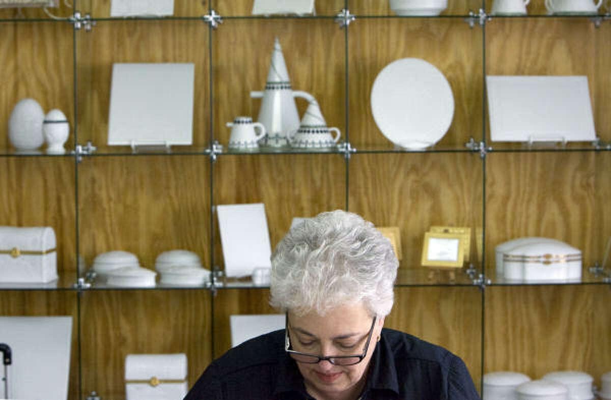Karen Grubaugh of Boerne paints porcelain in Cheri Holder's studio.