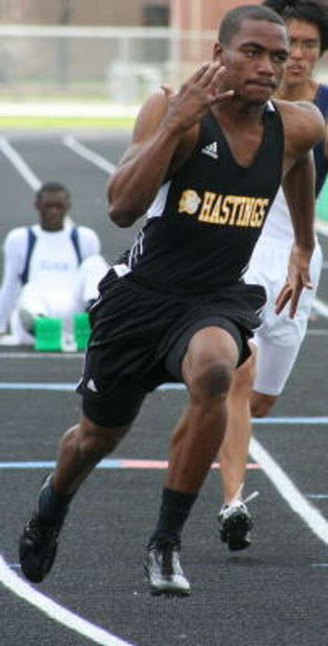 Hastings' Shaquille Tubman blasts out of the blocks in the 200-meter dash. Photo: Gerald James, For The Chronicle